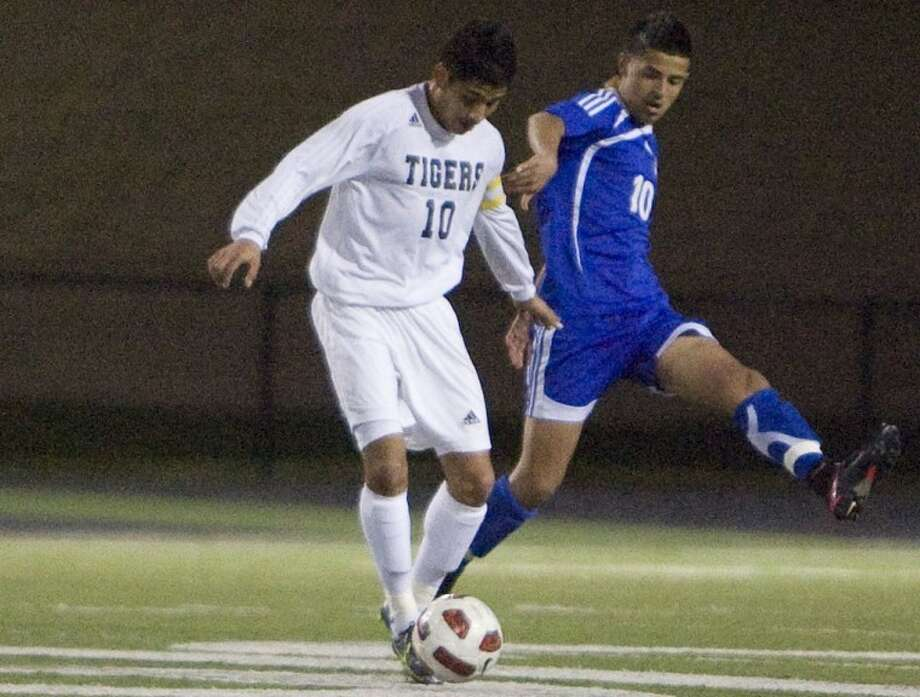 Conroe midfielder Gabriel Rivera, left, has helped the team bolt to a 5-0-2 start.