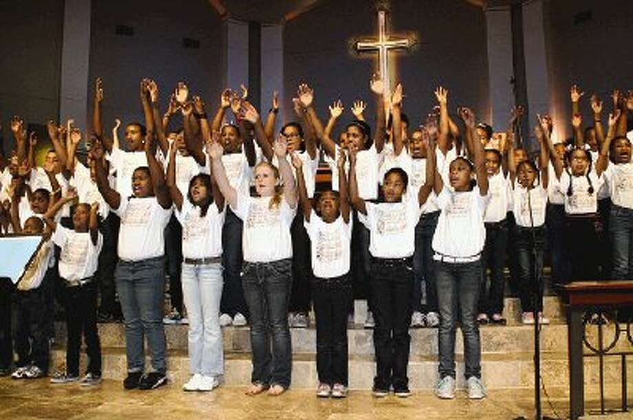 The Children's Mass King Choir received a standing ovation during the 25th annual Drum Major Award ceremony and commemorative celebration honoring Dr. Martin Luther King, Jr. Monday at Impact Church of The Woodlands.