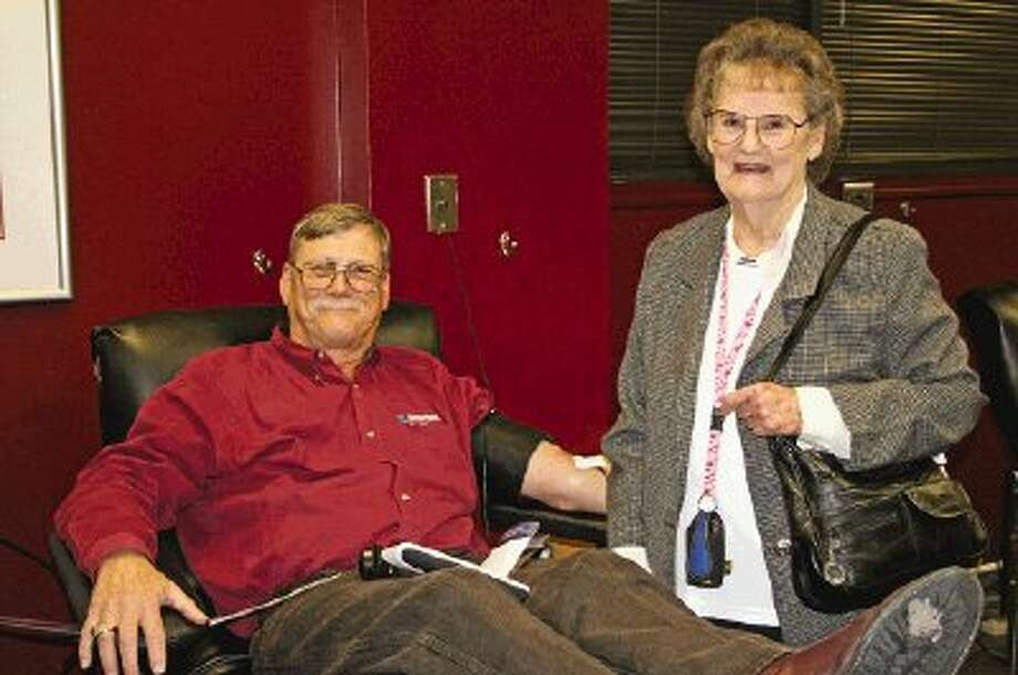 While making his 800th blood donation, Montgomery resident Glenn Speight chats with his mother, Ceole Speight, who was recently a blood recipient herself during open-heart surgery.