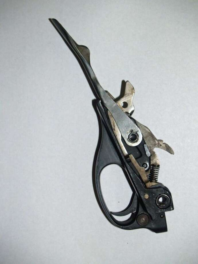 This trigger assembly is from a Remington semi-automatic shotgun. It has a few parts, but they are spring-loaded.