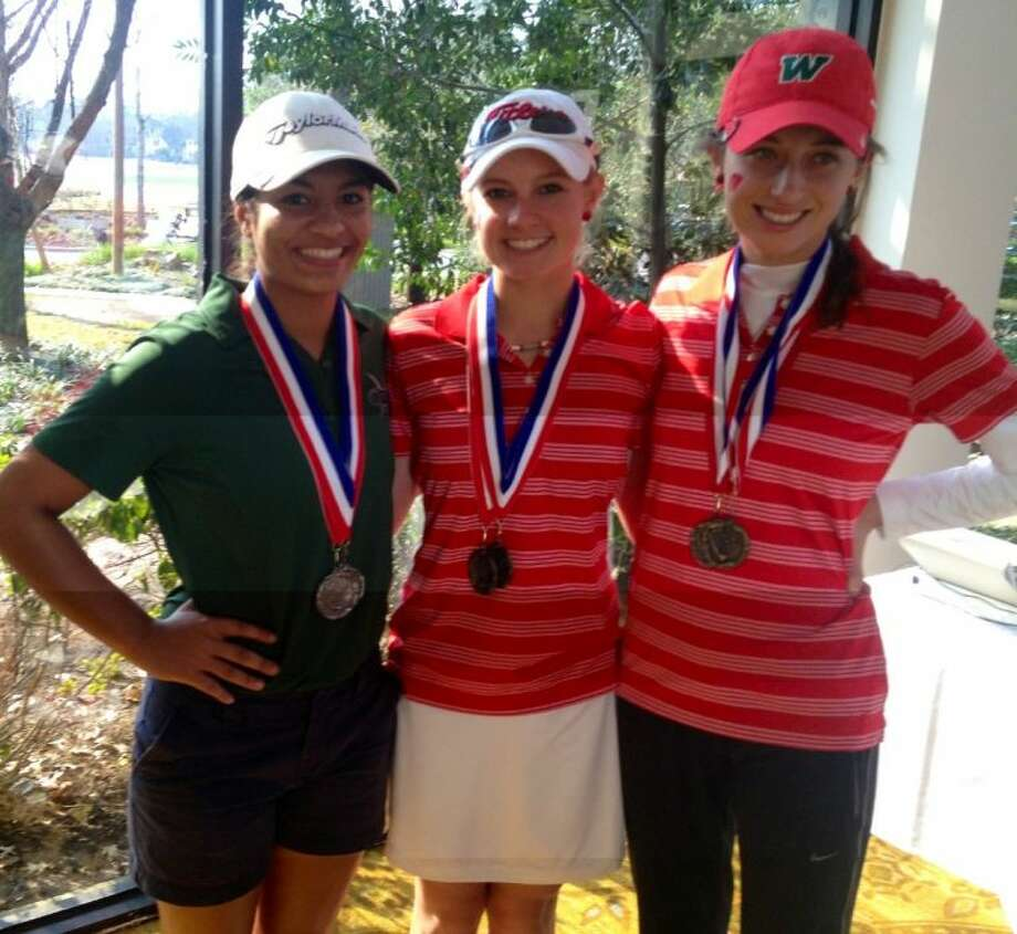 The Woodlands' Brooke McDougald, center, College Park's Meaghan Coleman, left, and The Woodlands' Kelly McGovern finished 1-2-3 at the Vern Edwards Memorial on Tuesday.
