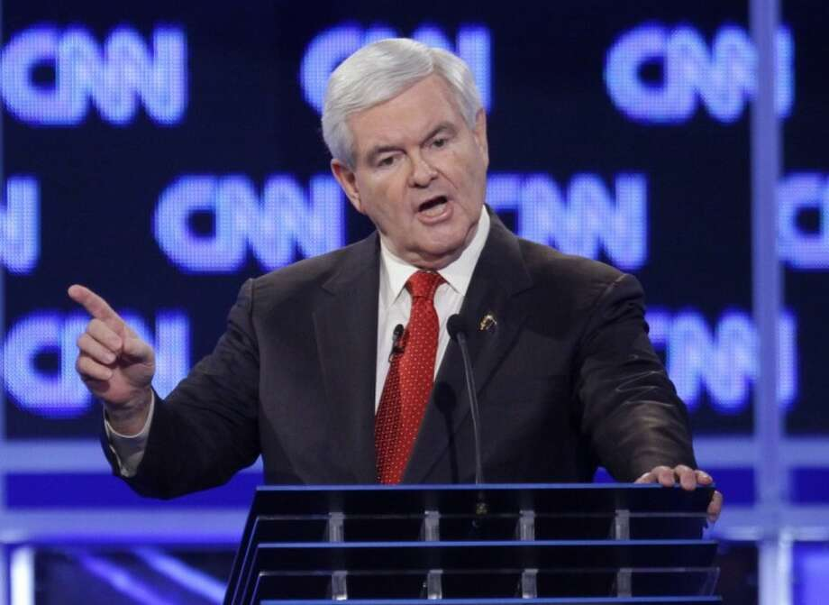 Republican presidential candidate former House Speaker Newt Gingrich reacts to a question at the start of the Republican presidential candidate debate at the North Charleston Coliseum in Charleston, S.C., Thursday. Photo: David Goldman