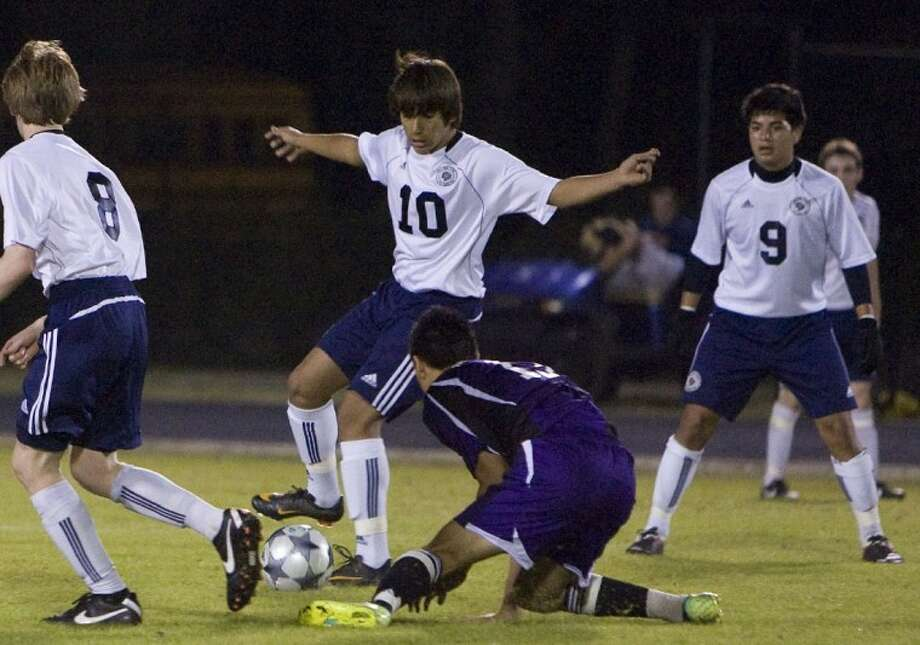 College Park's Santiago Montano dribbles past a Morton Ranch defender during Thursday night's game. Photo: Staff Photo By Eric S. Swist