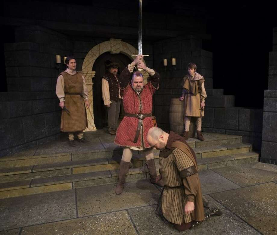 "Jeffrey Baldwin as King Henry hoists a sword in rehearsals for The Players Theatre Company's ""The Lion in Winter."" The show opens tonight at the Owen Theatre and continues weekends through Feb. 10."