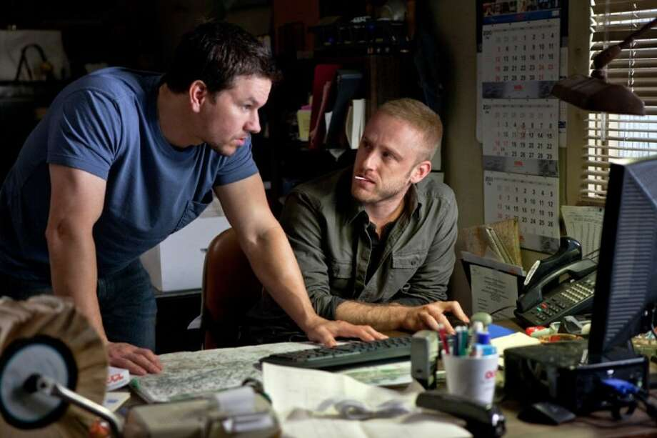 "In this film image released by Universal Pictures, Mark Wahlberg, left, and Ben Foster are shown in a scene from ""Contraband."" Photo: Patti Perret"