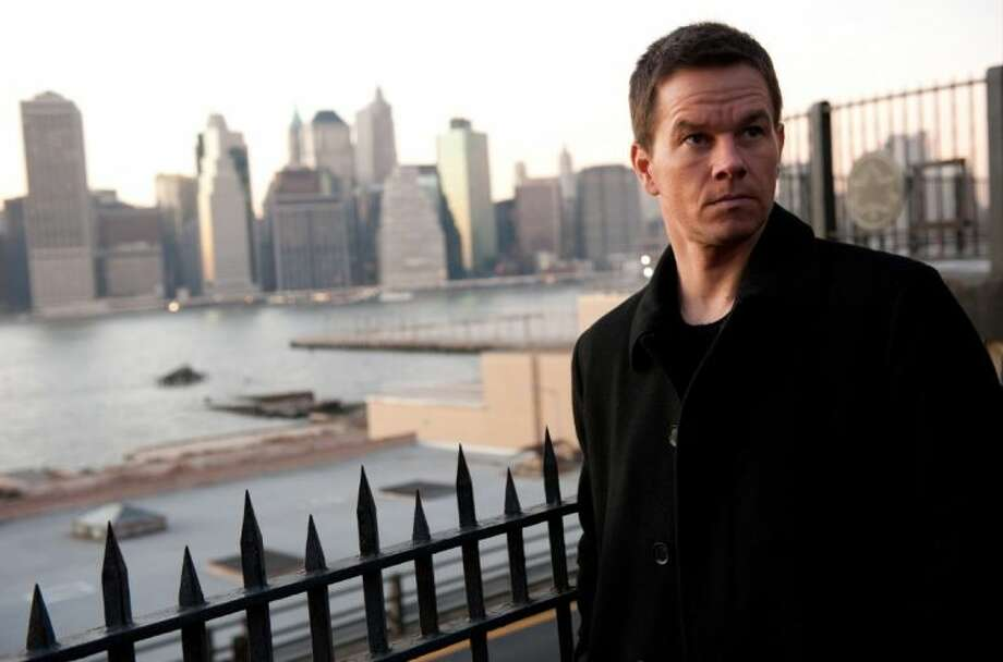 "This film image released by 20th Century Fox shows Mark Wahlberg in a scene from ""Broken City."" Photo: Barry Wetcher"