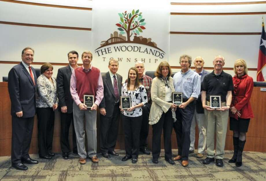 The Woodlands Township Board of Directors honored four Volunteers of the Year at its Volunteer Recognition and Town Hall Meeting Wednesday night. From left, Chairman Bruce Tough, Peggy S. Hausman, Gordy Bunch, Chris Florack, Ed Robb, Kristine Marlow, Mike Bass, Judy Easton, Steve Easton , Jeff Long, John Bell and Nelda Luce Blair.