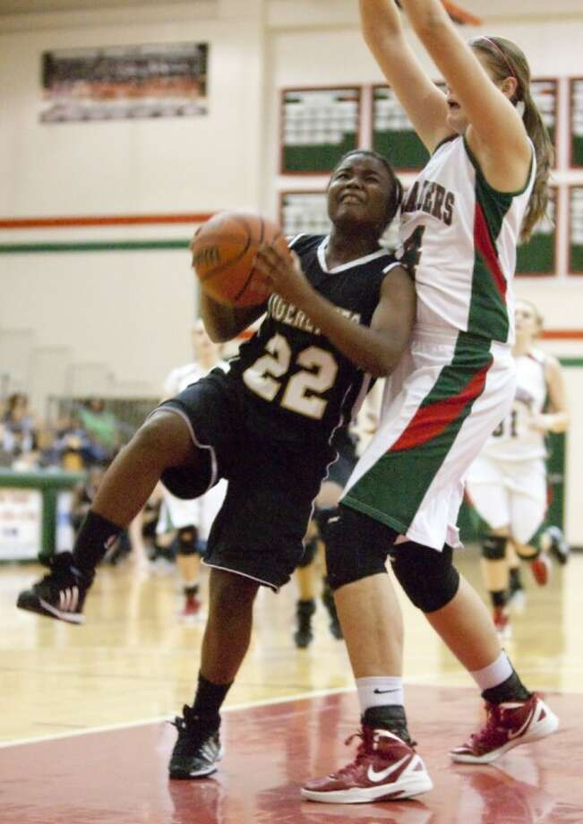 The Woodlands' Kelsey Lang smothers Conroe's Alexis Lewis on Friday at The Woodlands High School.