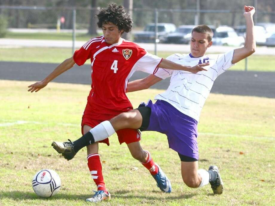 Caney Creek's Marcos Gallardo fights off a Jersey Village player during the Oak Ridge Tournament on Friday at Oak Ridge High School. See more photos online at www.yourconroenews.com/photos. Photo: Staff Photo By Karl Anderson