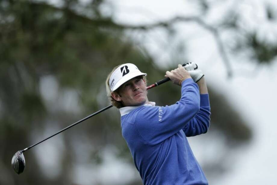 Brandt Snedeker watches his tee shot on the 11th hole of the North Course at the Torrey Pines Golf Course on Thursday during the first round of the Farmers Insurance Open. Snedeker, the defending champion, has a share of the first-round lead. Photo: Gregory Bull