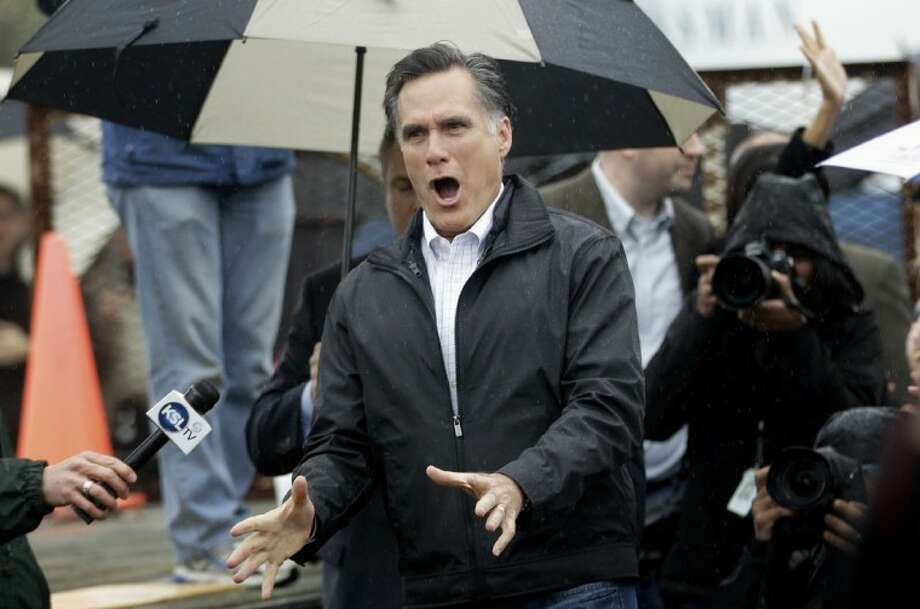 Republican presidential candidate, former Massachusetts Gov. Mitt Romney, reacts as he arrives to campaign at Harmon Tree Farm in Gilbert, S.C., Friday. Photo: Charles Dharapak