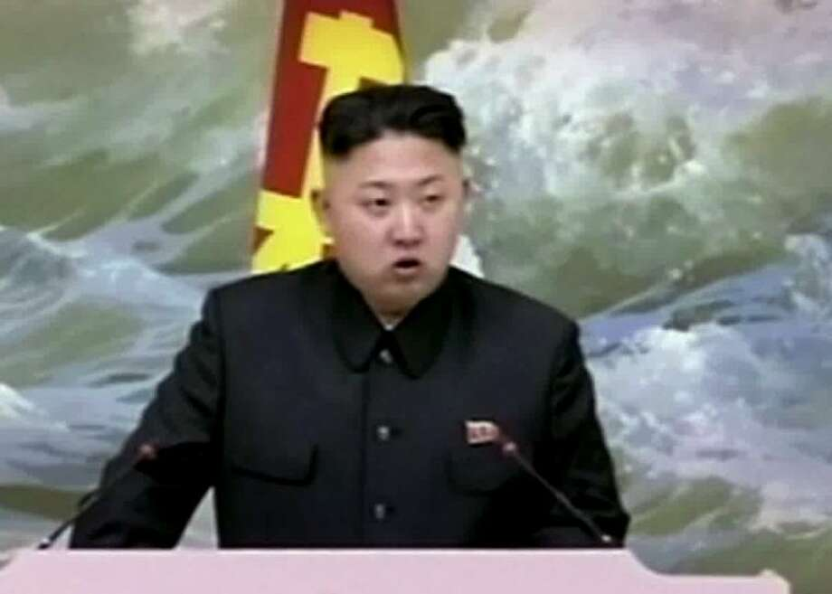 In this Dec. 21, 2012 file image made from video, North Korean leader Kim Jong Un speaks at a banquet for rocket scientists in Pyongyang, North Korea. North Korea's top governing body warned Thursday, Jan. 24, 2013 that the regime will conduct its third nuclear test in defiance of U.N. punishment, and made clear that its long-range rockets are designed to carry not only satellites but also warheads aimed at striking the United States. The National Defense Commission, headed by the country's young leader, rejected Tuesday's U.N. Security Council resolution condemning North Korea's long-range rocket launch in December as a banned missile activity and expanding sanctions against the regime. Photo: Uncredited