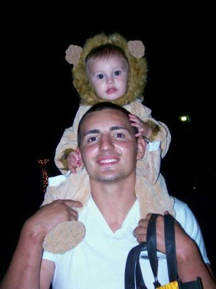 Jace Paul Valdez sits on his father's shoulders. Jace was killed by a pit bull while staying at his grandmother's home in Magnolia Jan. 14.