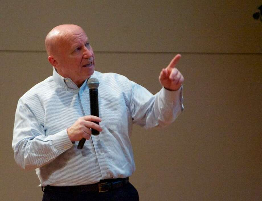 Congressman Kevin Brady, R-The Woodlands, speaks during a Town Hall style meeting held Thursday at the United Methodist Church in The Woodlands. Photo: Staff Photo By Eric Swist