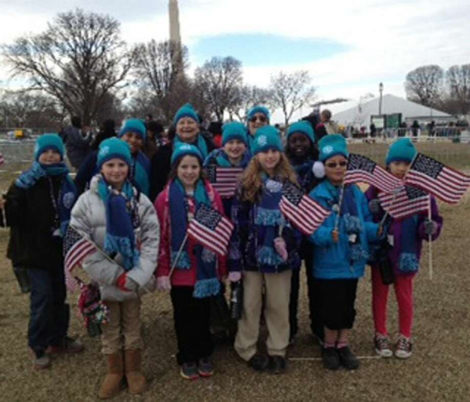 Ruthie McGrath, back center, is pictured with her group of nine-and-10-year-old students with People to People at the Presidential Inauguration on Monday.