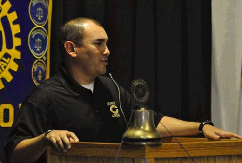 Conroe coach Manny Trujillo speaks to Rotary Club members during Tuesday's District 14-5A Baseball Preview.
