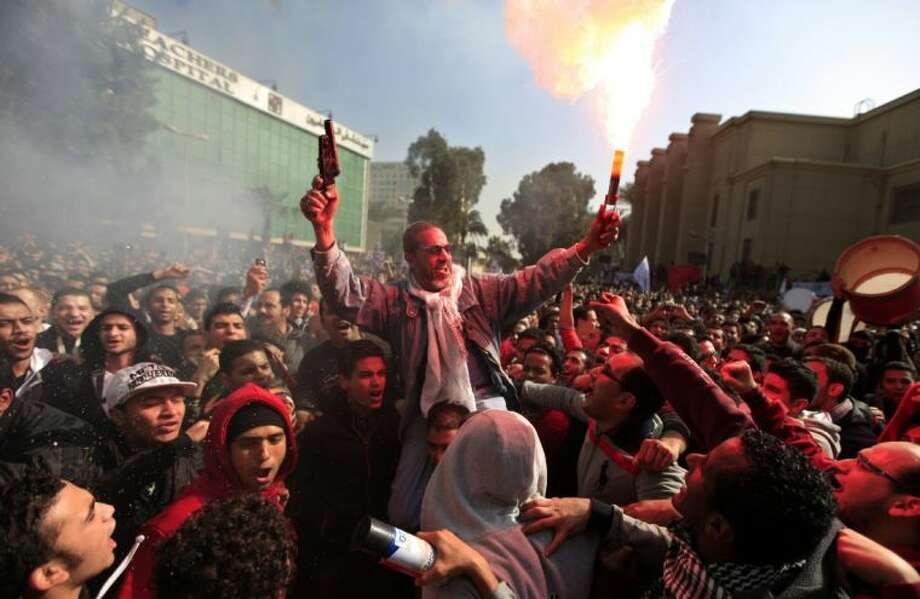 Egyptian soccer fans of Al-Ahly club celebrate a court verdict that returned 21 death penalties in last year's soccer violence. Photo: Khalil Hamra