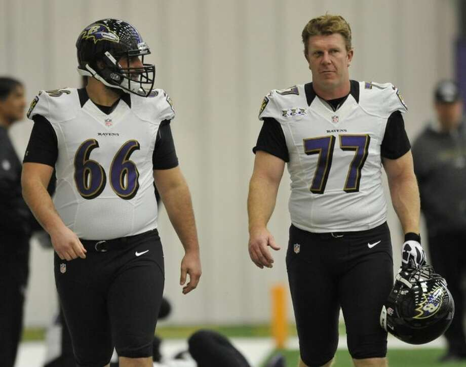 Ravens center Matt Birk, right, here pictured with teammate Gino Gradkowski, hasn't disclosed whether he'll retire after the Super Bowl. Birk is 36. Photo: GAIL BURTON
