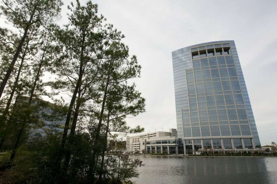 County commissioners unanimously approved a 10-year tax abatement agreement with Anadarko Realty Company for an expansion of the company's corporate office complex off Lake Robbins Drive in The Woodlands Monday. The Anadarko Tower is pictured at right. Photo: Karl Anderson