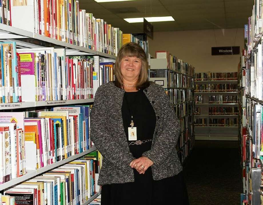 Twillia Liles, branch manager at the R.F. Meador Branch Library in Willis, will retire Jan. 31 after 24 years with the Montgomery County Memorial Library System. Liles has been the only manager at the Meador Branch since it opened in 1991. Photo: Staff Photo By Kassia Micek