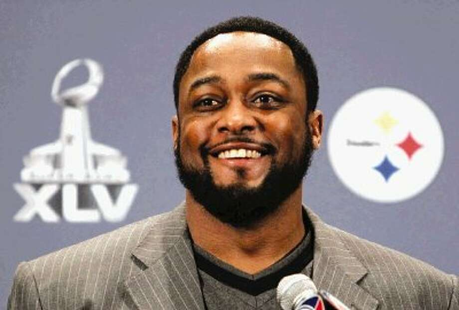 Pittsburgh Steelers coach Mike Tomlin smiles at a reporter's question during a news conference Monday in Fort Worth. / The Dallas Morning News