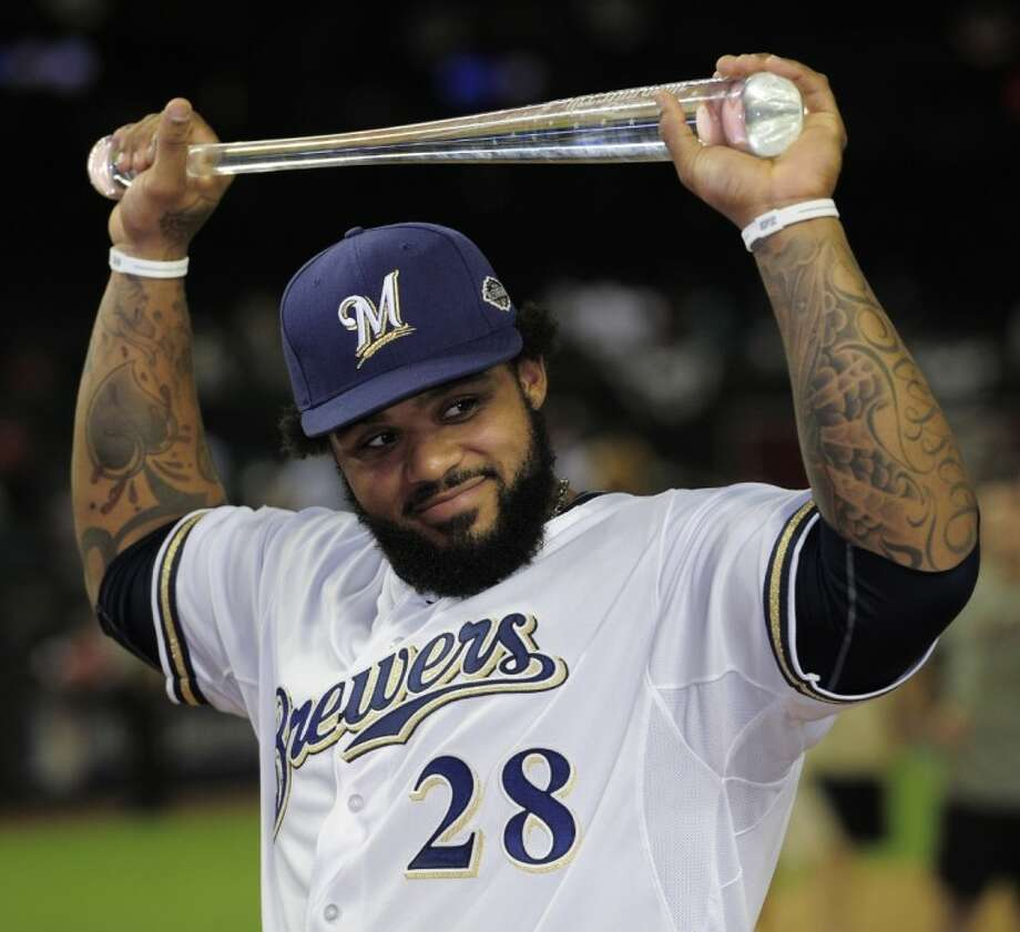 Prince Fielder of the Milwaukee Brewers holds his MVP award after the July 12, 2011, Major League Baseball All-Star game in Phoenix. Photo: Mark J. Terrill