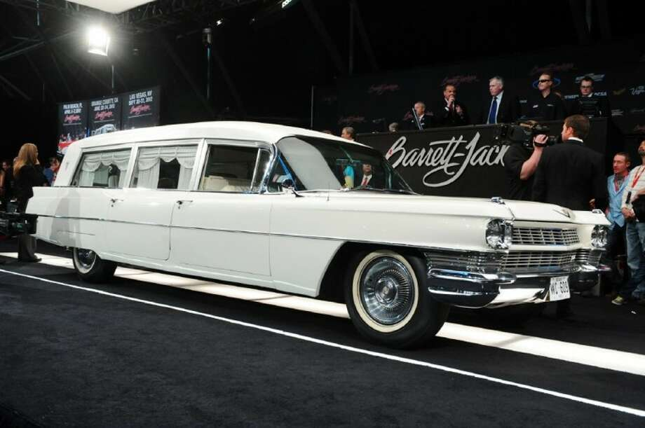 In this photo provided by Barrett-Jackson, the white hearse used to transport President John F. Kennedy's body following his assassination in Dallas is shown at auction Saturday in Scottsdale, Ariz. It sold for a bid of $160,000 plus a $16,000 fee to a collector and real estate developer from Boulder, Colo. Photo: HONS