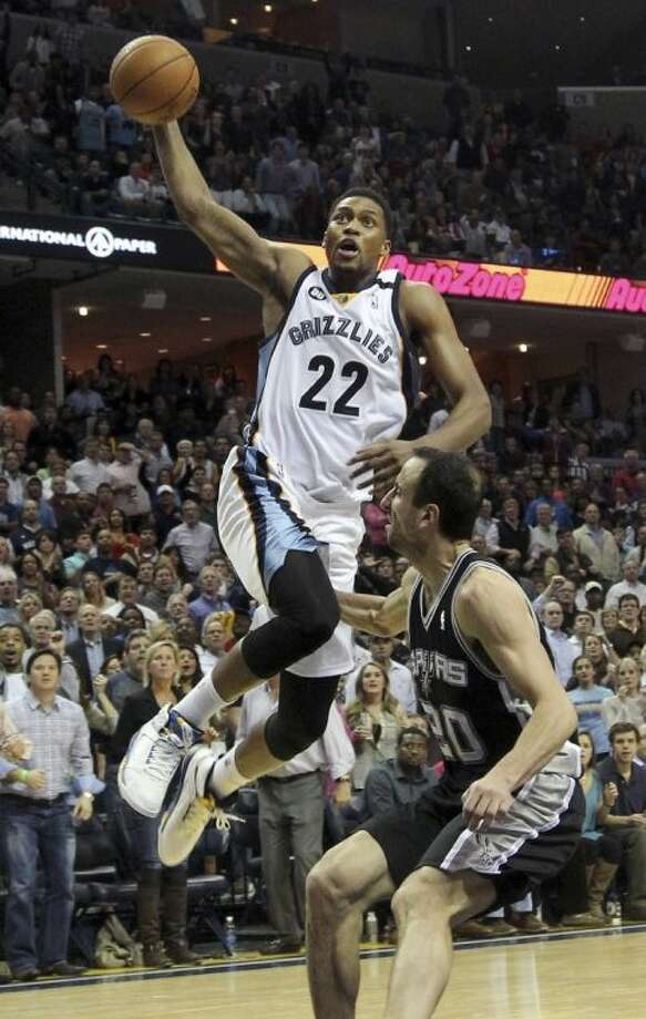 Memphis Grizzlies forward Rudy Gay goes to the basket over San Antonio Spurs guard Manu Ginobili during the second half Jan. 11 in Memphis, Tenn. Photo: Lance Murphey