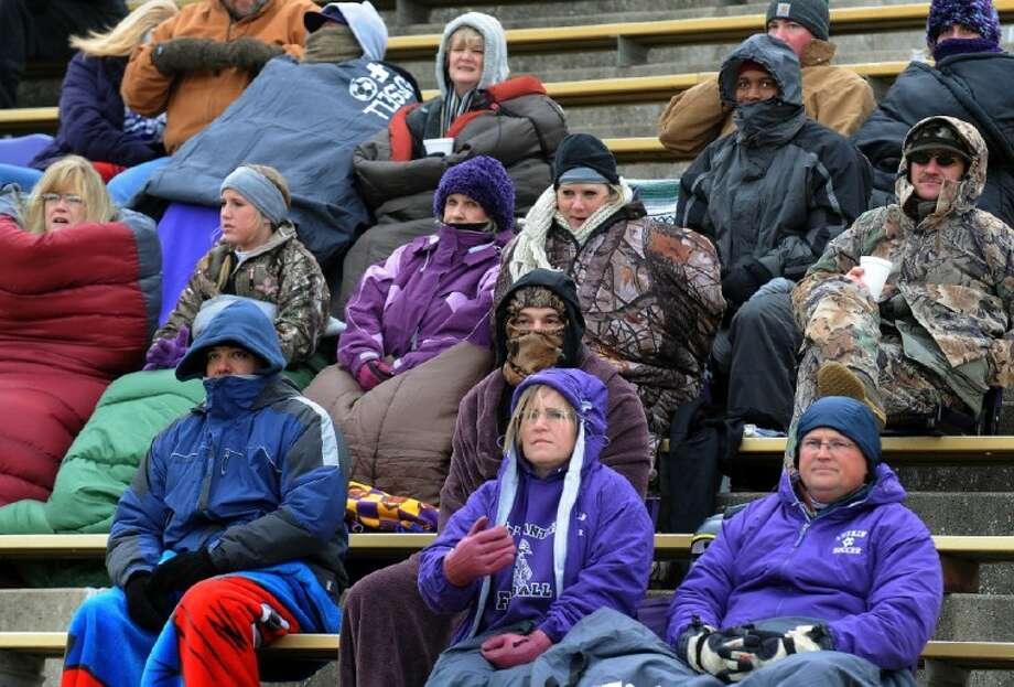 Soccer fans, bundled up against the cold and wind, watch as the Lufkin Lady Panthers play the Conroe Tigerettes at Lufkin High School's Abe Martin Stadium Tuesday. The Tigerettes lost 2-0. See soccer roundup, Sports. For more on the nation's cold weather, see page 4A.