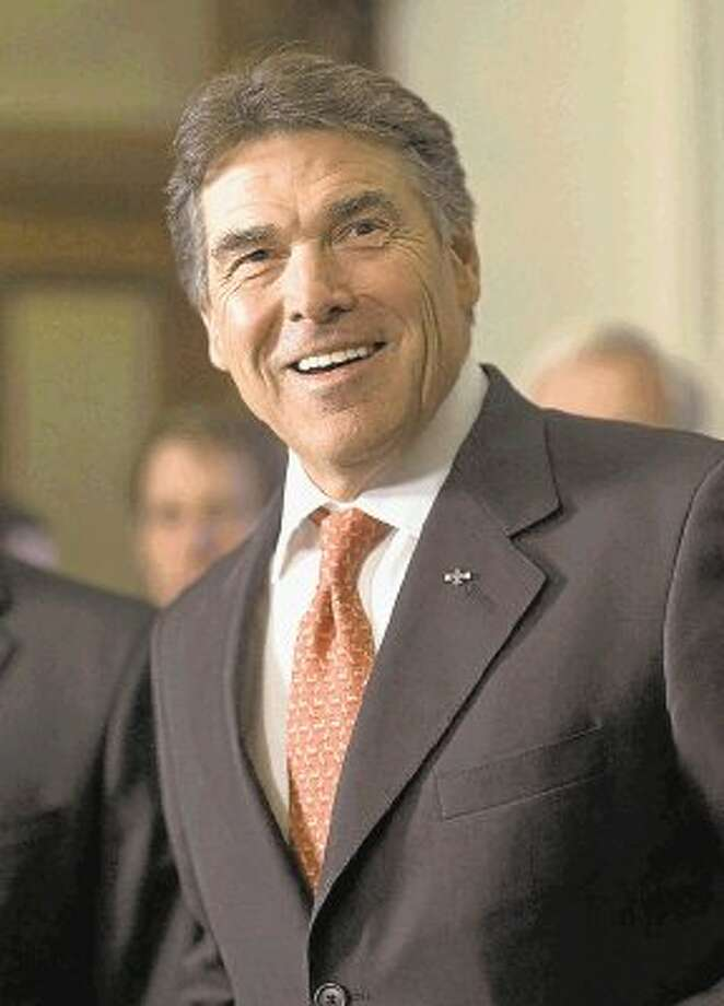 PERRY Photo: Harry Cabluck / AP2011