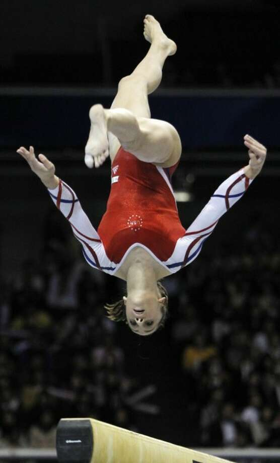 The United States' Jordyn Wieber performs on the balance beam during the women's team final at the Artistic Gymnastics World Championships on Oct. 11, 2011, in Tokyo, Japan. Photo: Bullit Marquez