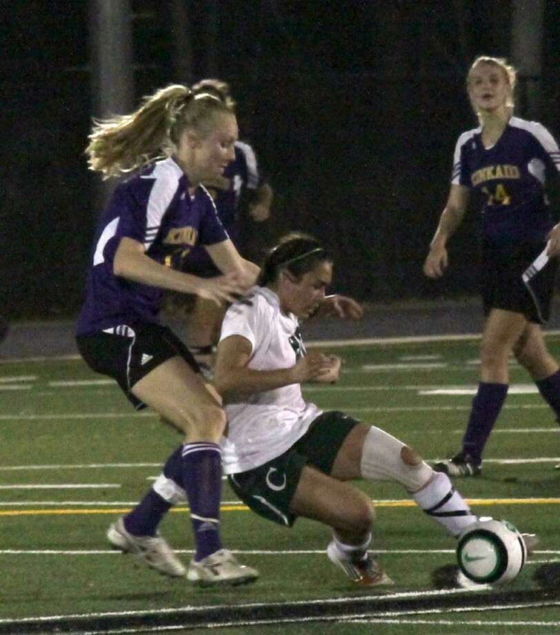 John Cooper junior Maddie Hayes fights for possession during the Lady Dragons' 2-0 home win Friday against Kinkaid.