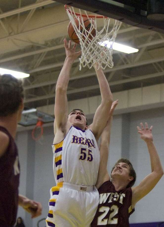 Montgomery's Currie Byrd goes up for a basket during Friday night's game against Magnolia West at Montgomery High School. Photo: Staff Photo By Eric S. Swist