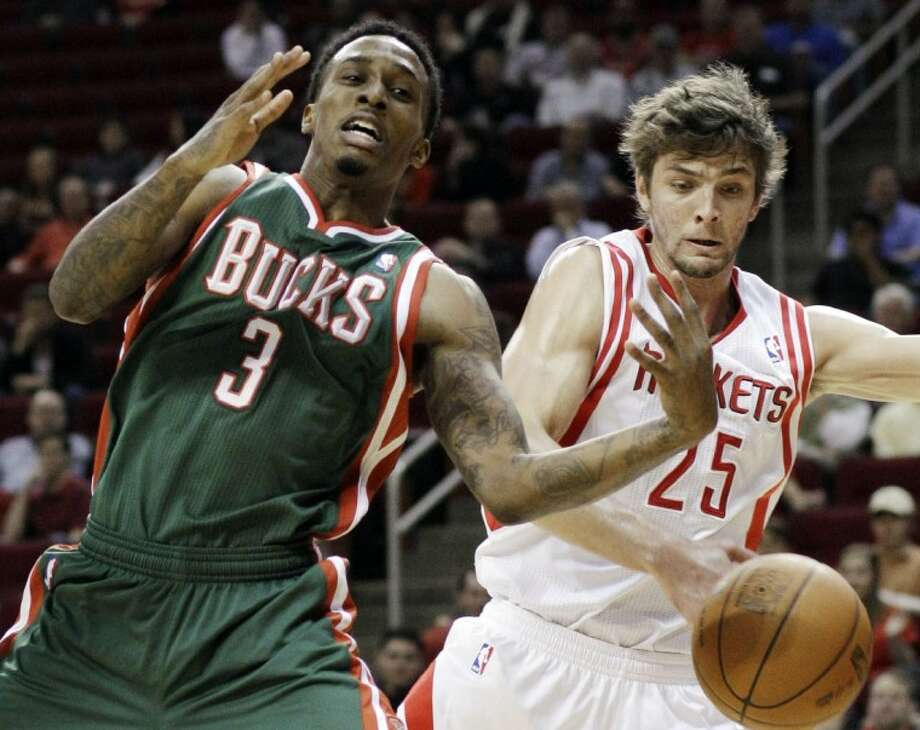 Milwaukee's Brandon Jennings loses the ball on a steal by Houston's Chandler Parsons in the first half Wednesday at Toyota Center. Photo: Pat Sullivan