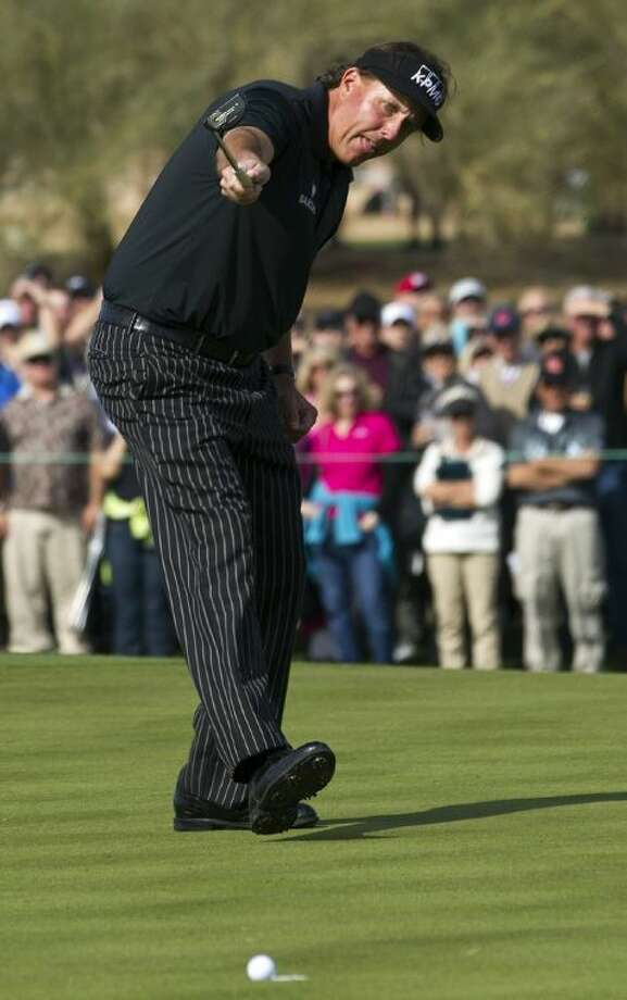 Phil Mickelson watches his birdie putt roll toward the cup on the ninth green during the first round of the Phoenix Open on Thursday in Scottsdale, Ariz. Mickelson's putt lipped out, and he had to settle for par. Photo: Rob Schumacher