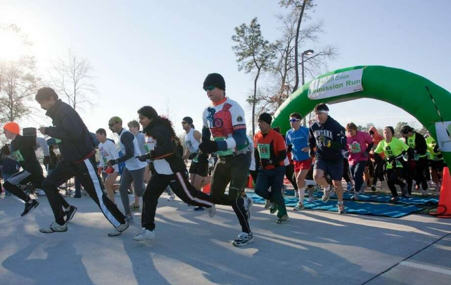 Runners take off from the starting line Saturday during the Bill Crews Remission Run held at Carl Barton Jr. Park in Conroe.