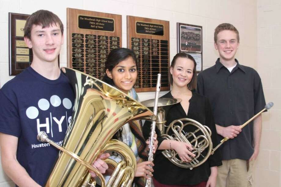 The Woodlands High School Band students Chris Torrisi (tuba), Niki Patel (flute), Alyx Henderson (french horn) and Dawson Riggs (percussion) pose for a photo Thursday. The four were selected to the Texas Music Educators Association's all-state band. The honor was the fourth for Henderson, third for Patel, second for Riggs and first for Torrisi. Photo: Jason Fochtman