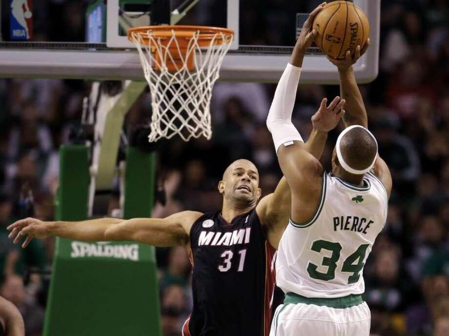 Boston Celtics forward Paul Pierce shoots over Miami Heat forward Shane Battier. The Celtics won 100-98 in two overtimes. Photo: Steven Senne