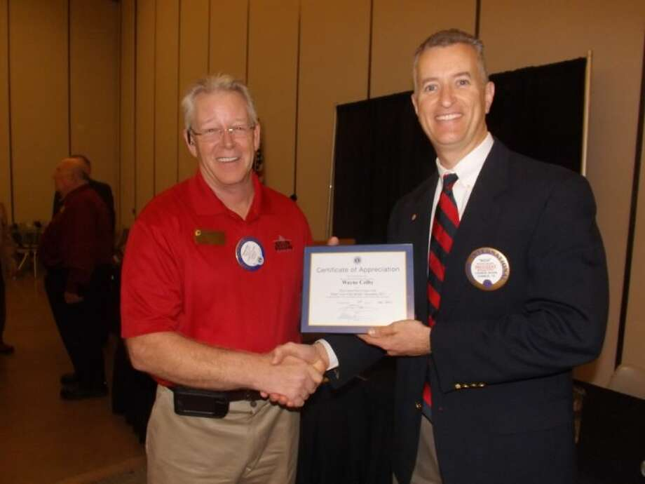 New Year ... New Lion: Conroe Noon Lions Club President Rich Sproba, right, congratulates new member Wayne Colby as he was nominated as 'Lion of the Month' for his quick involvement at the club's Eyeglass Recycling Center.