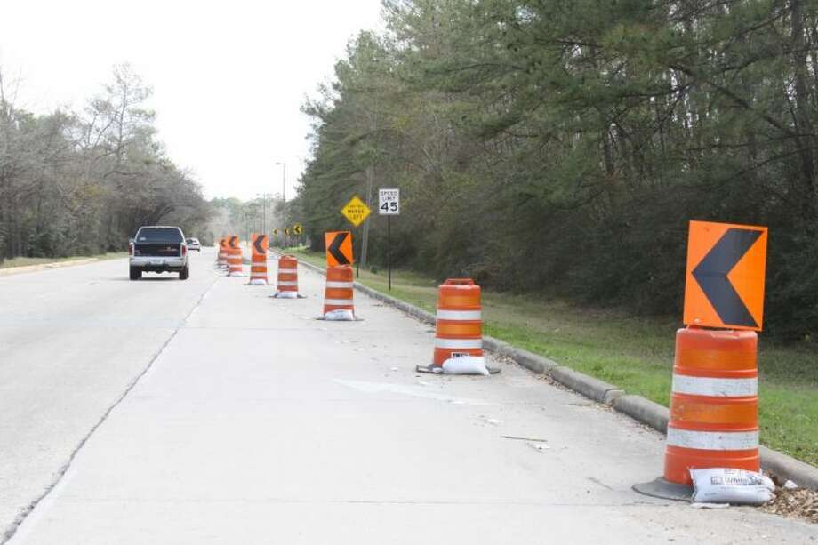 Signage along Woodlands Parkway near South Panther Creek Drive warns motorists of the narrow lanes ahead. The Conroe ISD has ordered bus drivers to use a different route until the construction is complete.