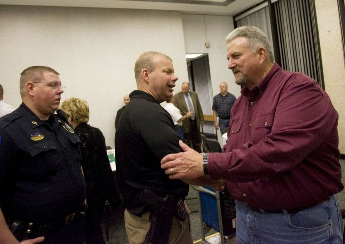 Conroe Police Department Sgt. Grange McCreary is congratulated by colleagues and friends during a retirement party Thursday at the Conroe Tower. McCreary is retiring after 33 years with the department.