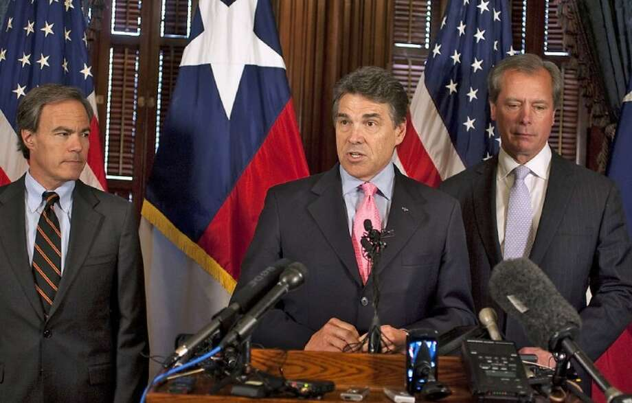 In this May 31, 2011 file photo, Texas Gov. Rick Perry, center, Speaker of the House, Joe Straus, left, and Lt. Gov. David Dewhurst, right, speak to members of the media at the State Capitol in Austin. Photo: Rodolfo Gonzalez