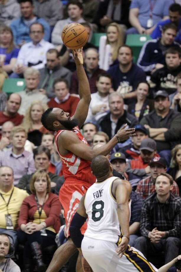 The Houston Rockets' James Harden (13) shoots against Utah Jazz's Randy Foye. The Rockets won 125-80. Photo: Rick Bowmer