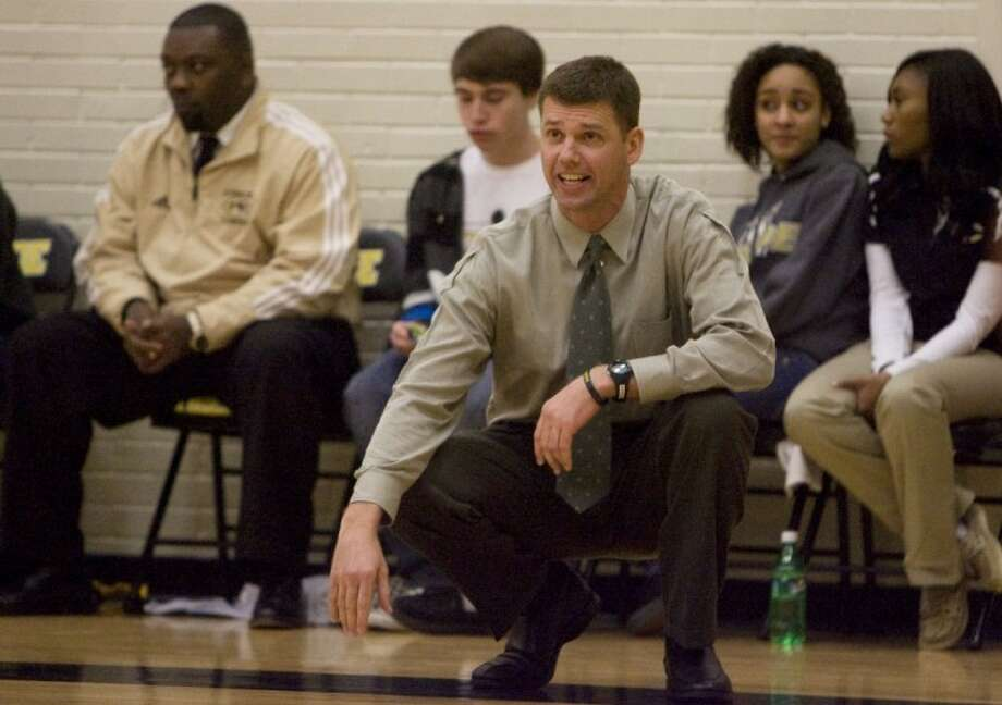 Conroe High School boys basketball Coach Jason Van Robays directs his team from the sidelines during a home game this season. Van Robays, a CHS graduate, and his Tigers will play tonight at Oak Ridge High School, where his former Conroe coach, Tommy Johnson, is now the principal. Photo: Staff Photo By Eric S. Swist