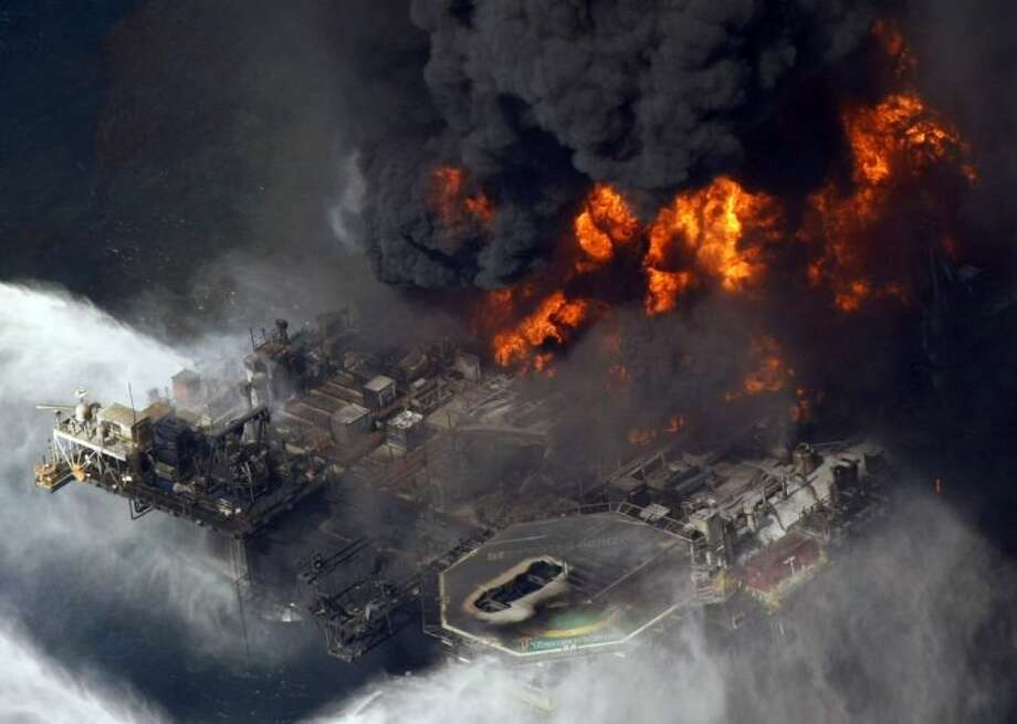 In this April 21, 2010 aerial file photo taken in the Gulf of Mexico more than 50 miles southeast of Venice, La., the Deepwater Horizon oil rig is seen burning. A U.S. judge on Tuesday, Jan. 29, 2013, approved an agreement for British oil giant BP PLC to plead guilty to manslaughter and other charges and pay a record 4 billion in criminal penalties for the company's role in the 2010 oil disaster in the Gulf of Mexico. Photo: Gerald Herbert