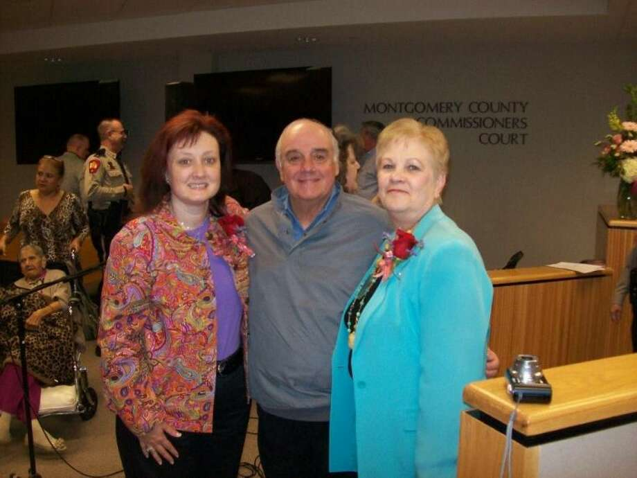 Shelly Lane, Children's Librarian, Precinct 1 Commissioner Mike Meador and Jerilynn Williams, Library Director, celebrate 15 years of service within Montgomery County and were awarded a pin to honor the accomplishment.