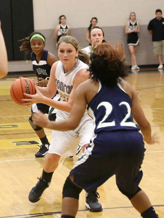 Conroe's Courtney Boatright, left, drives on College Park's Leah Breakfield. College Park won 67-37.