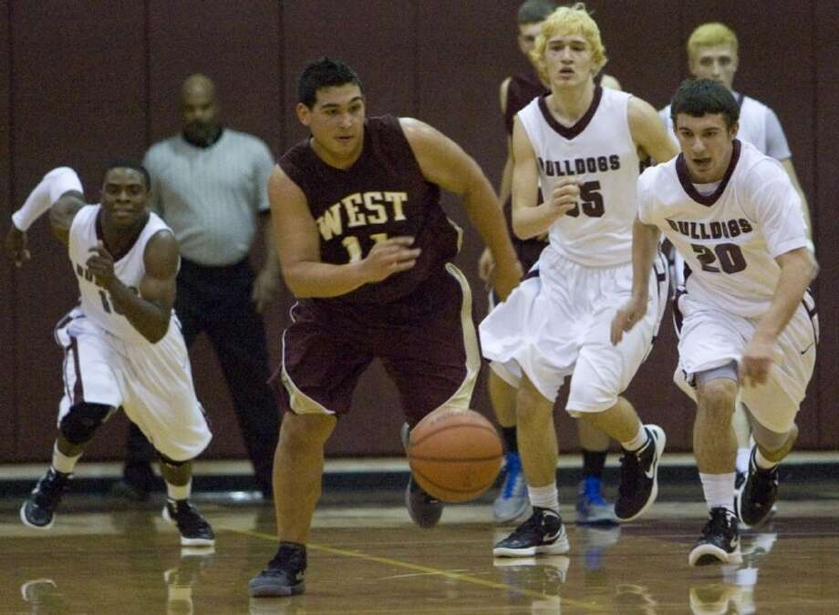 Magnolia West's Blake Gorman chases a loose ball during Friday night's district game at Magnolia High School. Photo: Staff Photo By Eric S. Swist
