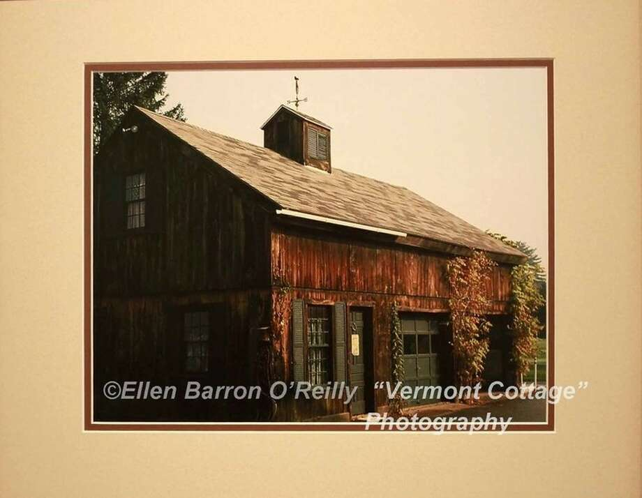 "A photograph titled, ""Vermont Cottage,"" by Ellen Barron O'Reilly, is currently on display at the Gallery at the Madeley building in downtown Conroe."