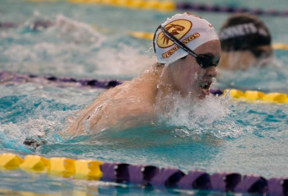 Magnolia West's Brendan Costello swims the first leg of the 200-yard medley relay at the District 19-4A swim meet, Saturday at the Montgoemry ISD Aquatic Center in Montgomery. Photo: Joseph Buvid